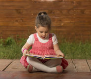 Expressive little girl reading loud Royalty Free Stock Photo