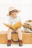 Expressive little girl reading old book Stock Photos
