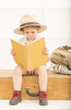 Expressive little girl reading old book Royalty Free Stock Image