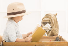 Expressive little girl reading old book Royalty Free Stock Photos