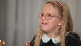 Expressive little girl telling interesting story stock video