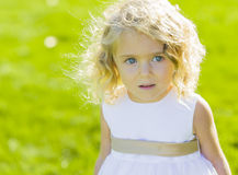 Expressive Little Girl in White Dress Royalty Free Stock Photos