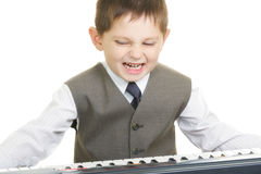Expressive little pianist Stock Photo