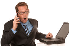 Expressive man on his cell phone. Businessman on his cell phone shows emotion as he says no over the deal on white backdrop Royalty Free Stock Image
