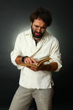 Expressive man reading a book Stock Photography