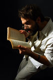 Expressive man reading a book Stock Images