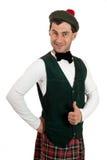 Expressive man in Scottish costume. Royalty Free Stock Photo