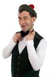 Expressive man in Scottish costume. Stock Photo