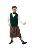 Expressive man in Scottish costume. Royalty Free Stock Photos