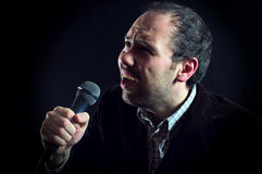 Expressive man singer with microphone Royalty Free Stock Photography