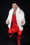 Expressive man in white fur coat. Royalty Free Stock Photos
