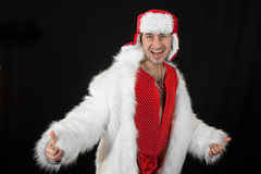 Expressive man in white fur coat. Royalty Free Stock Photo