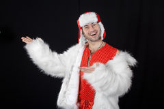 Expressive man in white fur coat. Stock Images
