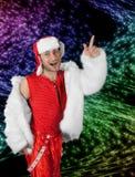 Expressive man in white fur coat. Royalty Free Stock Photos