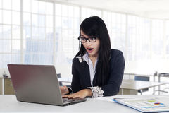 Expressive manager looking at laptop Stock Photos