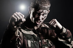 Expressive military man assaulting Stock Photo
