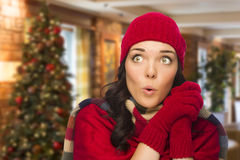 Expressive Mixed Race Girl Wearing Mittens and Hat In Christmas Setting Stock Photos