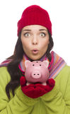 Expressive Mixed Race Woman Wearing Winter Hat Holding Piggybank Stock Photography