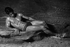 Expressive model. Expressive male model in the cave shoot in monochrome Stock Image
