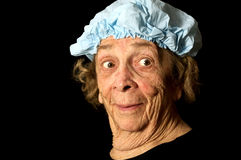 Expressive Old Woman. Portrait of an old woman in a blue hair cap Stock Image