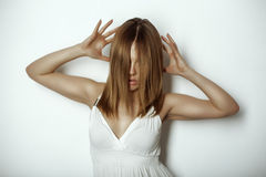 Expressive photo of beautiful woman with original hairstyle. On black background Stock Images