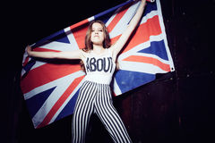 Expressive portrait of a beautiful young girl with a British flag Royalty Free Stock Photos