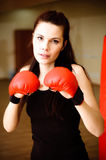 Expressive portrait of woman boxer. Portrait of woman in boxing-gloves Royalty Free Stock Photo
