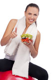 Expressive positive woman with salad Stock Images