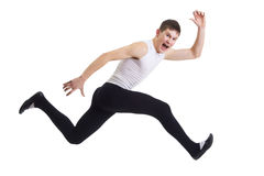 Expressive runs. A young man runs with an expressive face and screams. Isolation on a white background in the studio Royalty Free Stock Images