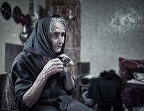 Expressive rural old woman indoor Royalty Free Stock Photography