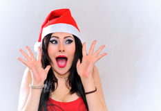 Expressive Santa claus girl Stock Photos