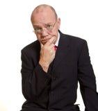 Expressive senior businessman. Isolated on white thinking concept royalty free stock photo