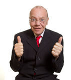 Expressive senior businessman. Isolated on white thumbs up concept stock photography