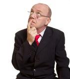 Expressive senior businessman. Isolated on white thinking concept stock image