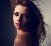 Expressive sensual makeup woman with pink lipstick and smokey ey. Es looking on black background. Art closeup portrait Stock Photography