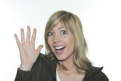 Expressive and smiling woman waving her hands Royalty Free Stock Photography