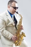 Expressive Stylish Caucasian Saxophone Player Performing in Whit Stock Photo