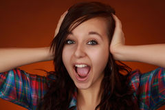 Expressive teen girl. Very expressive cute teen girl with hands on her head Royalty Free Stock Images