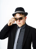 Expressive teenage boy dressed in suit Stock Photo