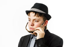 Expressive teenage boy dressed in suit Royalty Free Stock Photos