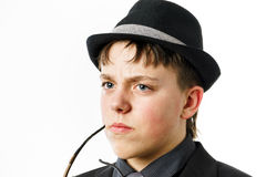 Expressive teenage boy dressed in suit Royalty Free Stock Photo