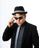 Expressive teenage boy dressed in suit Stock Photos