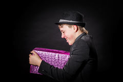 Expressive teenage boy holding box with gift Stock Photos