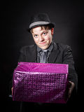 Expressive teenage boy holding box with gift Royalty Free Stock Photography