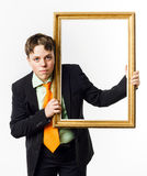 Expressive teenage boy posing with picture frame Stock Photo