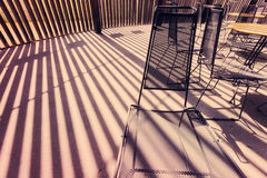 Metal Mesh Chairs and Stripes of Sunlight Royalty Free Stock Photography