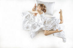 Expressive woman in action, dreaming concept. Royalty Free Stock Photos