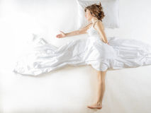 Expressive woman in action, dreaming concept. Royalty Free Stock Image
