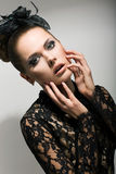 Expressive Woman in Black Dress touching her Emotional Face. Surprise royalty free stock photo