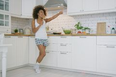 Expressive woman cooking in kitchen stock image